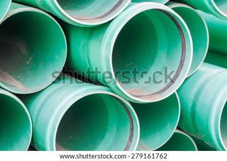 Green plastic pipes for drains water for building - stock photo