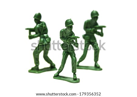 green plastic soldiers in formation - stock photo