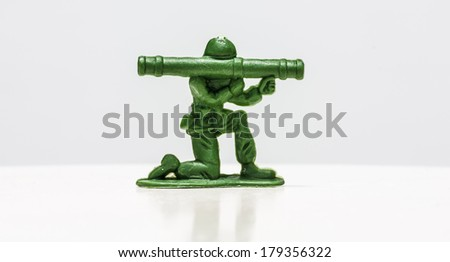 Green plastic soldiers on white background with launcher - stock photo
