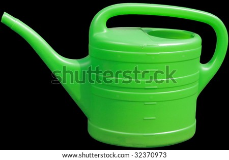 green plastic watering can - stock photo