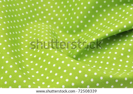 Green polka dot fabric in full frame - stock photo
