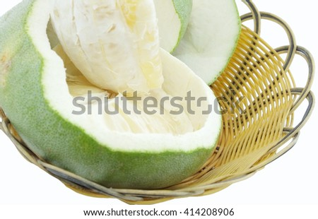 Green pomelo citrus fruit on wood Basket white background