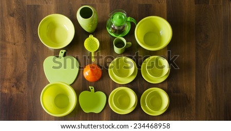 green porcelain dishes top view with an orange plastic funnel