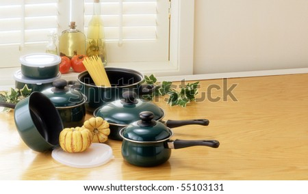 green pots and pans - stock photo