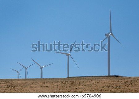 Green power is being produced from massive wind generators.