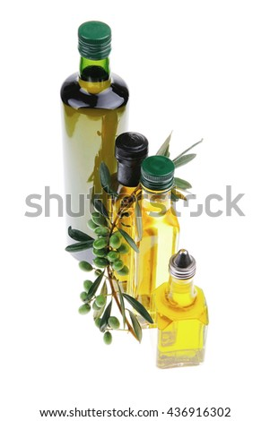 green raw olives with gold oil on white background - stock photo