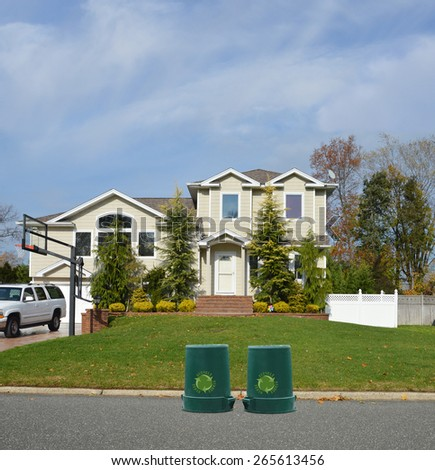 Green recycle, reuse, reduce, trash container Suburban McMansion Home Sunny Residential Neighborhood USA Blue Sky clouds - stock photo