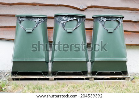 Green recycling containers isolate on white background - stock photo