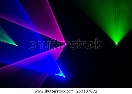 Green, Red and blue laser beams - stock photo