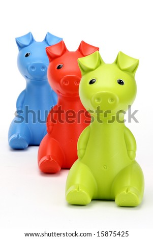 Green, Red, and blue piggy banks in a row. - stock photo