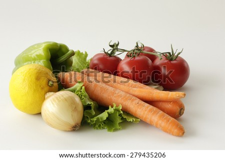 Green,red and orange vegetables as healthy food on isolated white background
