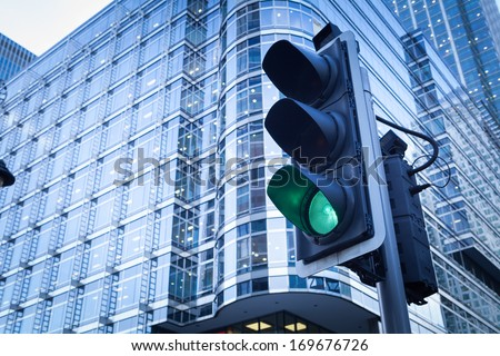 Green & Red Traffic Light in the city, in Canary Wharf office, London  - stock photo