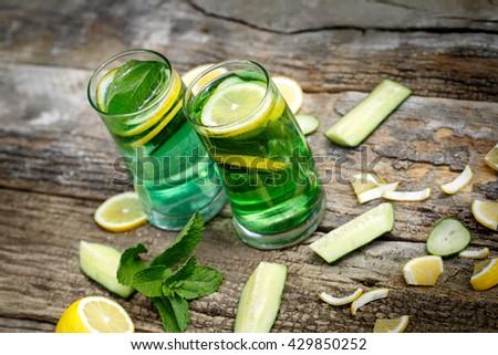Green refreshing juice - green vitamin drink - stock photo