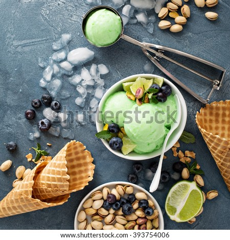 Green refreshing lime pistachio  ice cream in white bowl overhead shot - stock photo