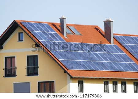 Green renewable energy with photovoltaic installations on the roof. - stock photo