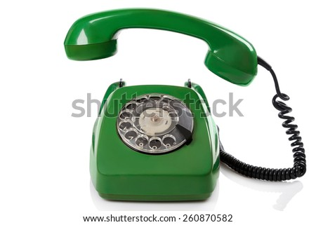 Green retro telephone on white background - stock photo