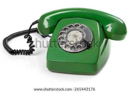 Green retro telephone on white background - stock photo