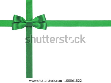 Green ribbon with a bow on a white background - stock photo