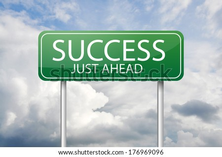 """Green road sign """"Success just ahead"""" - stock photo"""