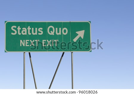 Green road sign with a blue sky gradient background.