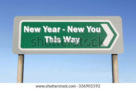 Green road sign with the message of a New Year - New You This Way concept against a blue sky background - stock photo