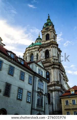 Green roof of St. Nicholas Church in the quarter of Mala Strana in Prague in Central Europe - stock photo