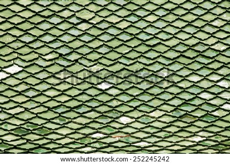 Green roof tiles made of terracotta background. - stock photo