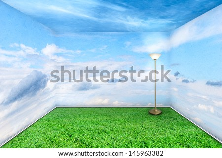 Green room interior with grass floor and sky walls clouds - stock photo
