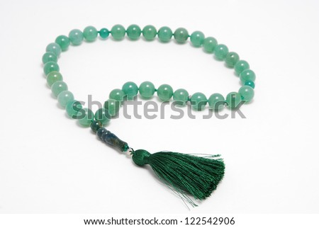 Green Rosary Beads, from gem on white background - stock photo