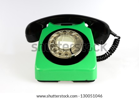 Green rotary phone isolated on white - stock photo
