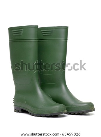 Green rubber boots isolated on white background. - stock photo