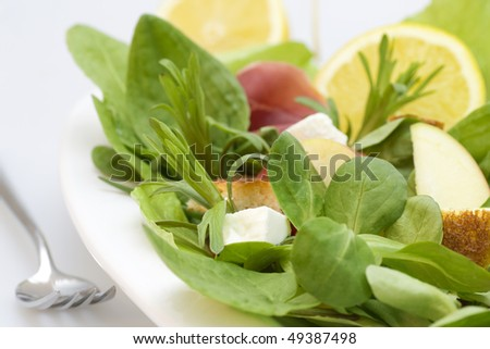 Green salad with apple,croutons,tomatoes,bacon,lemon and feta cheese