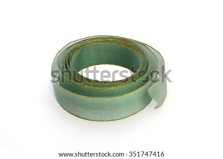 Green sheer ribbon with golden rim on white background