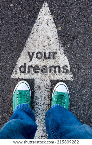 Green shoes standing on your dreams sign - stock photo