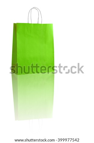 Green shopping bag on white with reflexion (with space for your logo or text)