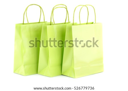 Green shopping bags isolated on white background.