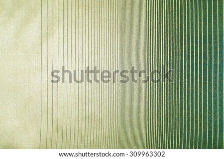 green silk fabric texture, salad coloring. Green silk drapery. Isolated as a whole background. - stock photo