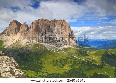 Green slopes around Sassolungo massif as seen from Piz Selva, Dolomite Alps, Italy - stock photo