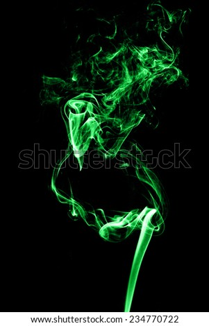 Green smoke on a black background.