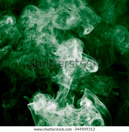 green smoke on a black background - stock photo