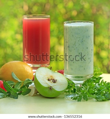 Green smoothie and strawberry juice - stock photo