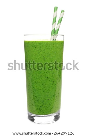 Green smoothie in a glass with straws isolated on a white background - stock photo