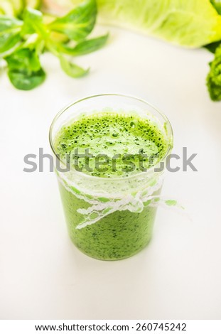 Green smoothie in glass, close up - stock photo