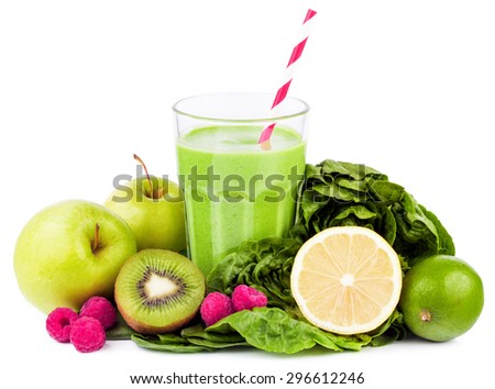 green smoothie with fruits and vegetables on white background - stock photo