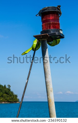 Green snake on light bulb in the sea. - stock photo