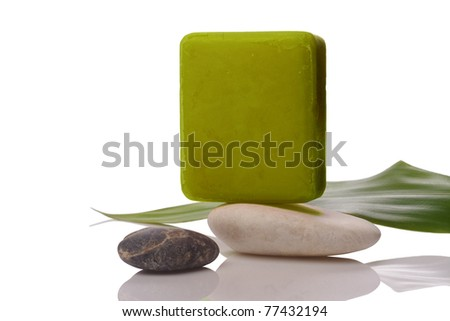 green soap and stone on white with clipping paths - stock photo