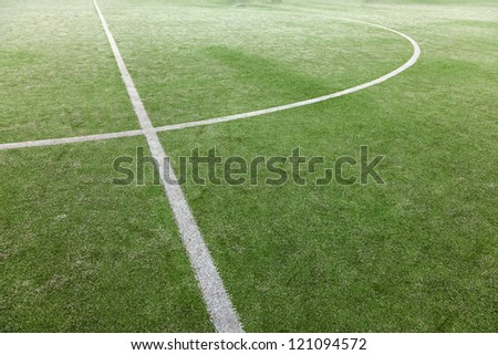 green soccer field with white lines