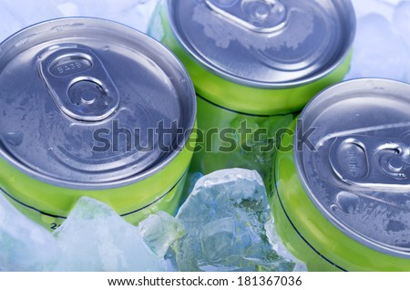 green Soda can in crushed ice - stock photo