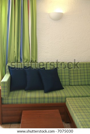 Green sofa and curtain - stock photo