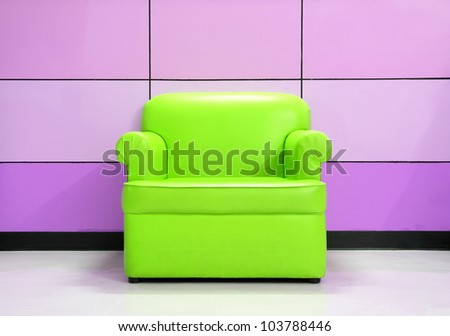 Green sofa and modern wall - stock photo